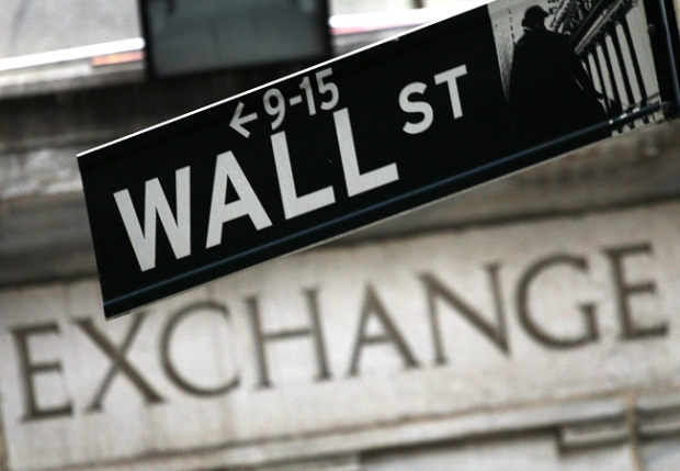 A Wall St. sign hangs in front of the New York Stock Exchange, Tuesday, Sept. 30, 2008. (AP / Mark Lennihan)