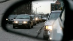 Commuters are reflected in a rearview mirror while sitting in rush hour traffic in Toronto in this March 4, 2008 photo. (J.P. Moczulski/THE CANADIAN PRESS)