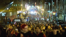 Protesters opposing student tuition fee hikes demonstrate in Montreal, Sunday, April 29, 2012. (Graham Hughes / THE CANADIAN PRESS)