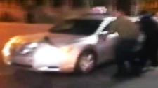 New video shows ground view of a taxi running over a man in Montreal Sunday, April 29, 2012.