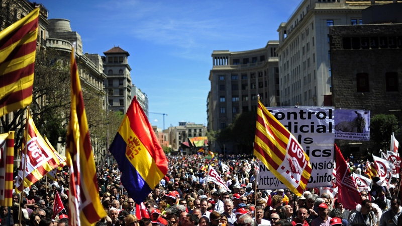 People protest during a May Day rally in the center of Barcelona, Spain, Tuesday, May 1, 2012. (AP Photo/Manu Fernandez)