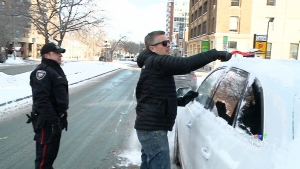 Const. Phil Kane of the Ottawa Police Department says the snow and ice buildup that drivers neglect to brush off cars can pose a deadly hazard to fellow drivers. (File photo)