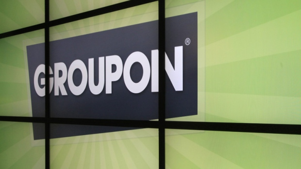 In thisfile photo, the Groupon logo is displayed inside the online coupon company's offices, in Chicago. (AP Photo/Charles Rex Arbogast, File)