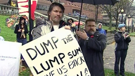 A veteran protests outside of a federal court in Halifax as he waits for the results on Tuesday, May 1, 2012.