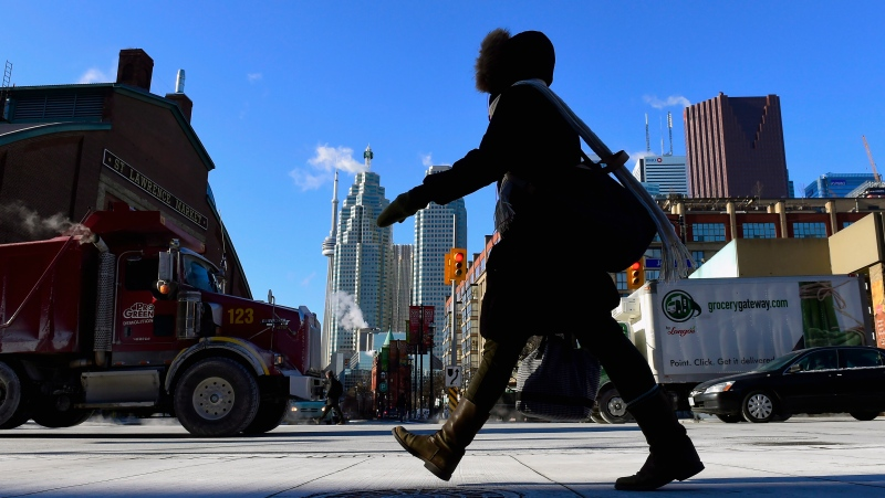 A woman walks in downtown Toronto on Jan. 7, 2015. Ontario is shivering through a deep freeze with Environment Canada issuing an extreme cold warning for most of the province. (Frank Gunn / The Canadian Press)