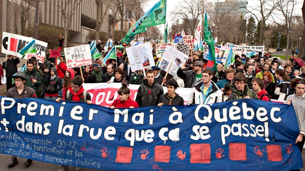 Students and workers walk to the legislature in a May Day protest in Quebec City, Tuesday, May 1, 2012. (Jacques Boissinot / THE CANADIAN PRESS)