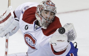 Montreal Canadiens goalie Carey Price reaches for the puck during the second period of an NHL hockey game against the Dallas Stars on Dec. 6, 2014, in Dallas. (LM Otero / AP Photo)
