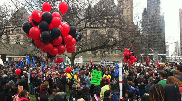 Marchers gather in Nathan Phillips Square for May Day on Tuesday, May 1, 2012. CTV/Natalie Johnson