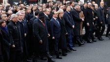 Thousands gather in Paris to honour victims
