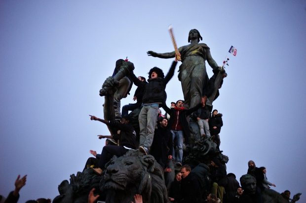 People gather atop a statue at Place de la Nation during a rally in Paris, Sunday, Jan. 11, 2015. (AP / Thibault Camus)
