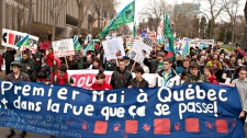 Students and workers walk to the legislature in a May Day protest Tuesday, May 1, 2012 in Quebec City.  (Jacques Boissinot/ THE CANADIAN PRESS)