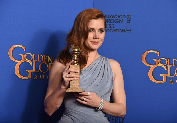 Amy Adams poses in the press room with the award for best actress in a motion picture - musical or comedy for 'Big Eyes' at the 72nd annual Golden Globe Awards at the Beverly Hilton Hotel on Sunday, Jan. 11, 2015, in Beverly Hills, Calif. (Photo by Jordan Strauss / Invision / AP)
