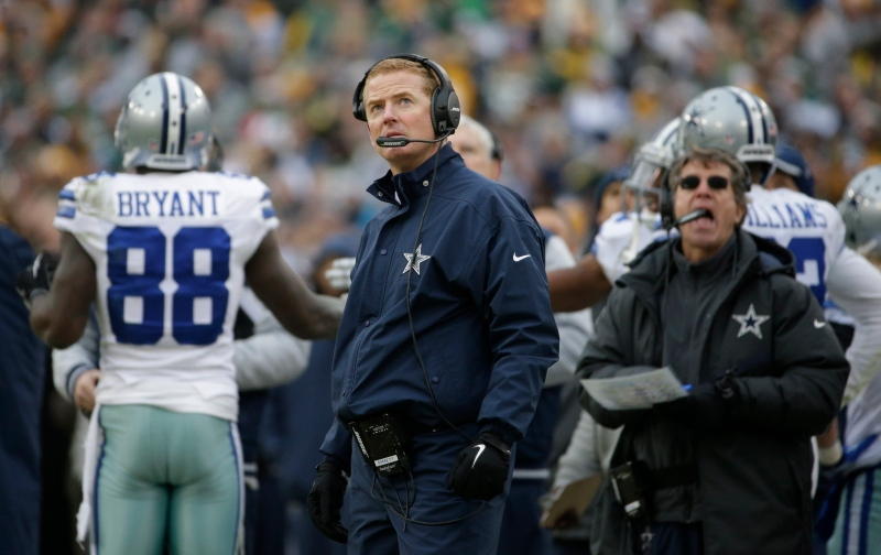 Dallas Cowboys head coach Jason Garrett watches the scoreboard as officials review a catch by Dallas Cowboys wide receiver Dez Bryant during the second half of an NFL divisional playoff football game Sunday, Jan. 11, 2015, in Green Bay, Wis. The call was reversed. (AP / Nam Y. Huh)