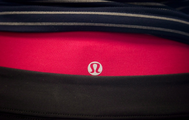 Lululemon's logo is seen on clothing displayed on a mannequin in downtown Vancouver on August 21, 2014. (Darryl Dyck / THE CANADIAN PRESS)