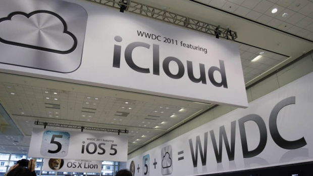 In this June 6, 2011 file photo, posters are displayed at the Apple Worldwide Developers Conference in San Francisco.