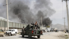 Smoke billows out from a compound after it was attacked by militants in Kabul, Afghanistan, Wednesday, May 2, 2012. (AP Photo/Musadeq Sadeq)