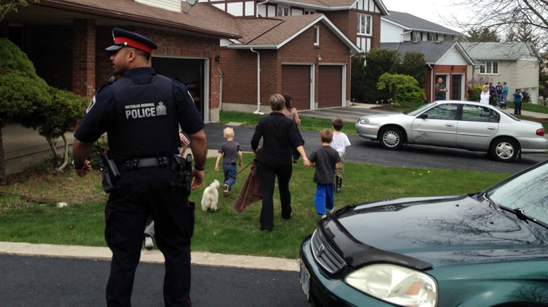 Residents are escorted from the area near a fire along Ralston Place in Waterloo, Ont. on Wednesday, May 2, 2012. (David Imrie / CTV News)