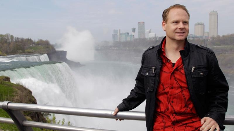 Nik Wallenda poses for photos after a news conference in Niagara Falls, N.Y., Wednesday, May 2, 2012. (AP / David Duprey)