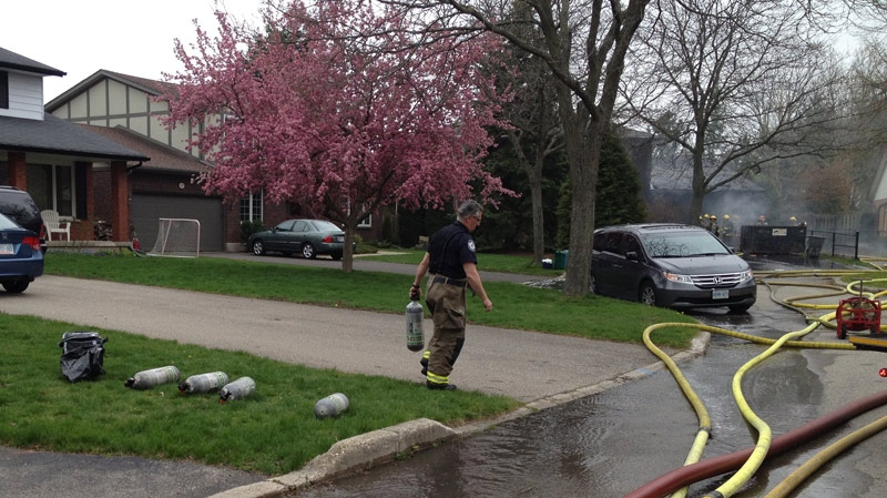 Smoke from a fire is seen along Ralston Place in Waterloo, Ont. on Wednesday, May 2, 2012. (David Imrie / CTV News)