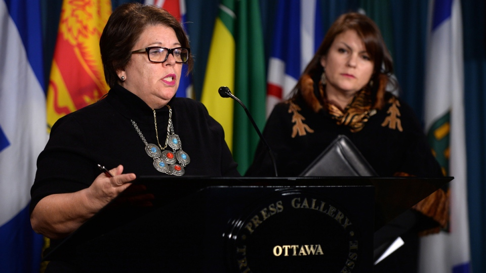 Dr. Dawn Harvard, right, of the Native Women's Association of Canada (NWAC) looks on as Claudette Dumont-Smith, Executive Director of NWAC answers questions as they take part in a press conference on Parliament Hill in Ottawa on Monday, Jan. 12, 2015. (Sean Kilpatrick / THE CANADIAN PRESS)