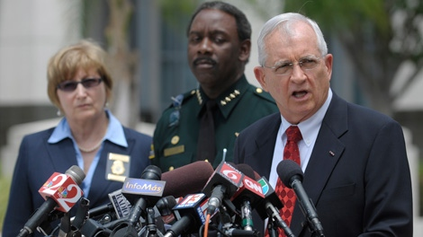 Florida State Attorney Lawson Lamar, right, announces charges against 13 people in the hazing death of Florida A&M University drum major Robert Champion during a news conference in Orlando, Fla., Wednesday, May 2, 2012. (AP / Phelan M. Ebenhack)