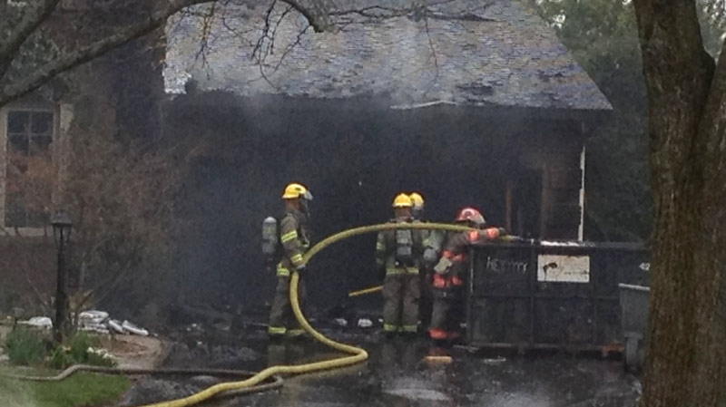A damaged garage is seen after a fire on Ralston Place in Waterloo, Ont. on Wednesday, May 2, 2012. (David Imrie / CTV News)