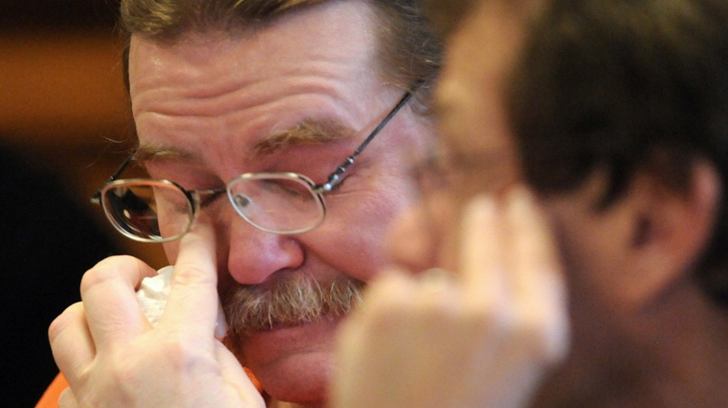 Convicted murderer Ronald Smith becomes emotional during his clemency hearing in Powell County District Court in Deer Lodge, Mont on Wednesday, May 2, 2012. (AP / The Missoulian, Michael Gallacher)