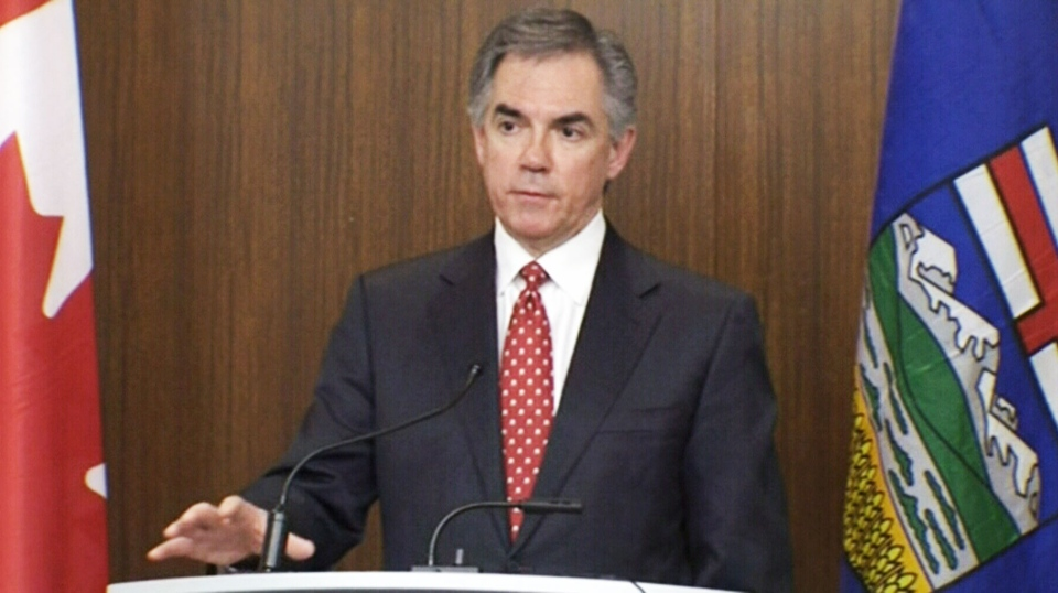 Alberta Premier Jim Prentice speaks to reporters on Tuesday, Jan. 13, 2015.