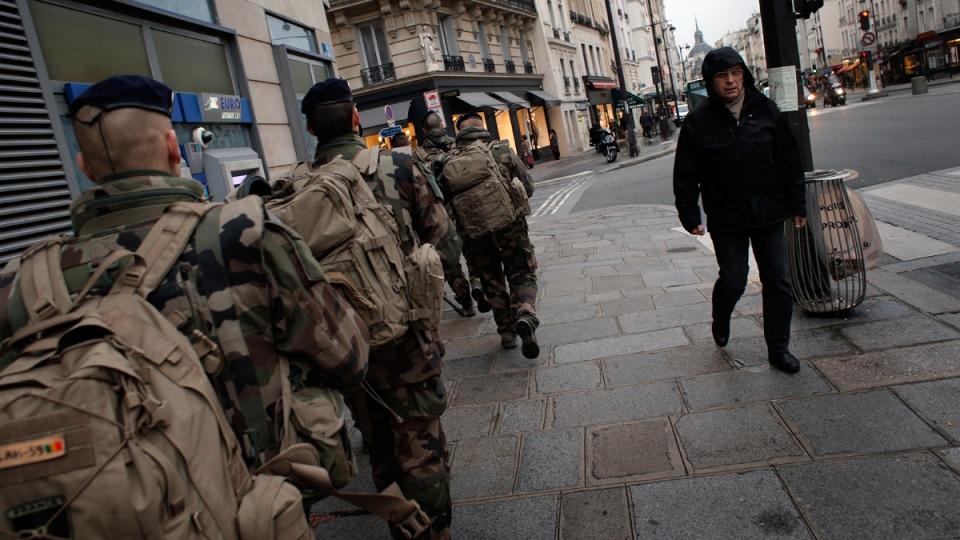 Soldiers patrol a street in Paris