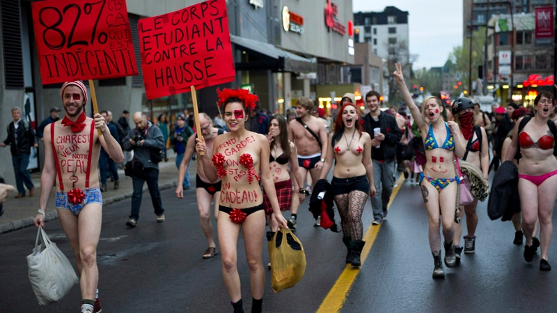 Students march in the streets of Montreal as they hold a naked protest against tuition hikes Thursday, May 3, 2012. One Facebook group cites several reasons for the unique protest including: catching the government's attention; the mayor not wanting protesters to wear masks; distracting police officers; and also because it's spring, they say. THE CANADIAN PRESS/Paul Chiasson