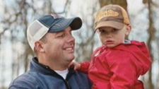 Two-year-old Larsen (right) is shown with his dad Rob Brunel.
