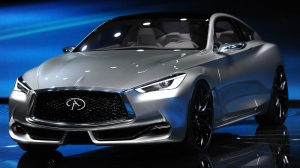 The Infiniti Q60 concept car is presented during media previews for the North American International Auto Show in Detroit, Tuesday, Jan. 13, 2015. (AP / The Grand Rapids Press, Tanya Moutzalias)