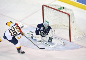 In this file photo, Erie Otters right wing Nick Betz (29) scores on Plymouth Whalers goaltender Alex Nedeljkovic at Erie Insurance Arena in Erie, Pa. on Wednesday, Nov. 19, 2014. (AP Photo/Erie Times-News, Andy Colwell)