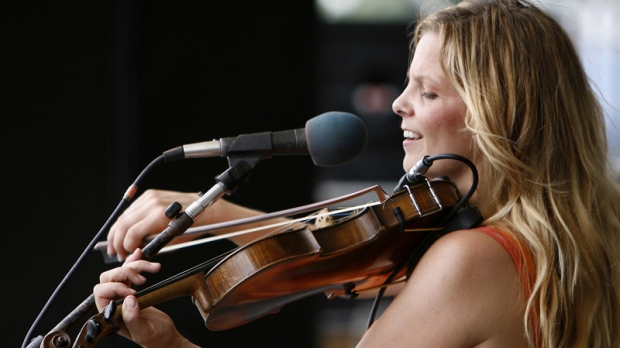 In this May 6, 2006 file photo, Theresa Andersson of the Theresa Andersson Group performs during the 2006 New Orleans Jazz and Heritage Festival in New Orleans. (AP Photo/Alex Brandon, file)