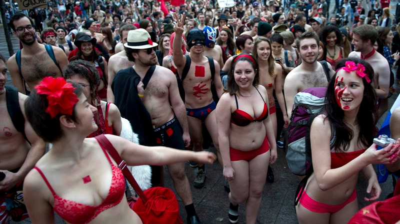 Students march in the streets of Montreal as they hold a naked protest against tuition hikes Thursday, May 3, 2012. THE CANADIAN PRESS/Paul Chiasson