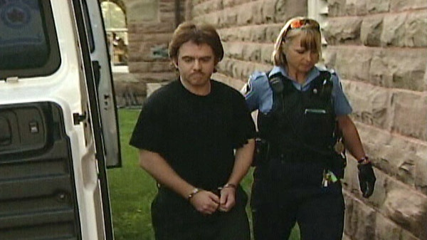 John Douglas Robinson is seen outside the courthouse in Woodstock, Ont. in this undated image taken from video.