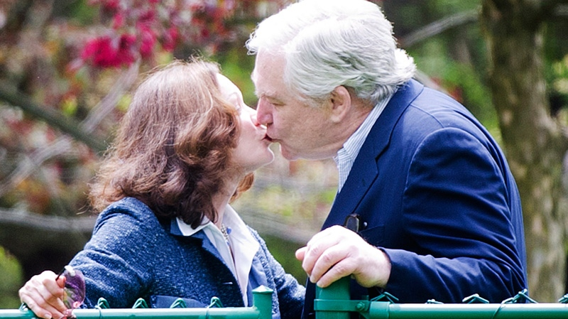 Conrad Black, right, kisses his wife Barbra Amiel Black as he arrives at his Bridle Path residence in Toronto on Friday, May 4, 2012. . (Nathan Denette / THE CANADIAN PRESS)
