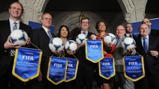 Representatives from the six host cities (Edmonton, Moncton, Montreal, Ottawa, Vancouver and Winnipeg, respectively) help FIFA and the Canadian Soccer Association announce the host cities for the 2015 FIFA Women's World Cup on Parliament Hill in Ottawa on Friday, May 4, 2012. (THE CANADIAN PRESS/Sean Kilpatrick)