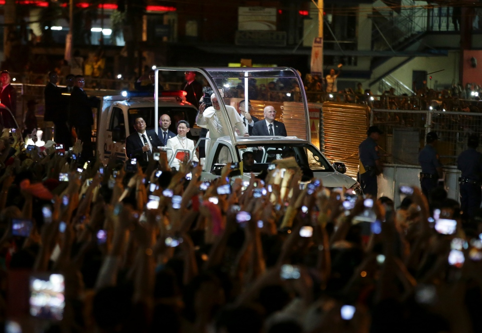 Pope Francis waves to Filipinos upon his arrival in Manila, Philippines Thursday, Jan. 15, 2015. (AP / Aaron Favila)