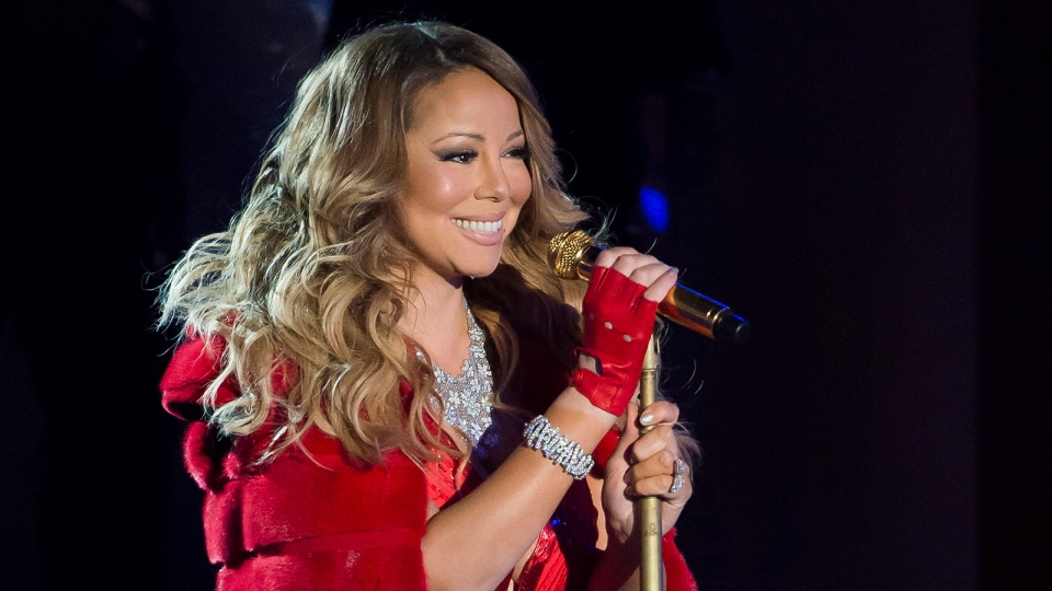 Mariah Carey performs at the 82nd Annual Rockefeller Center Christmas tree lighting ceremony in New York, Dec. 3, 2014. (Sykes/Invision)