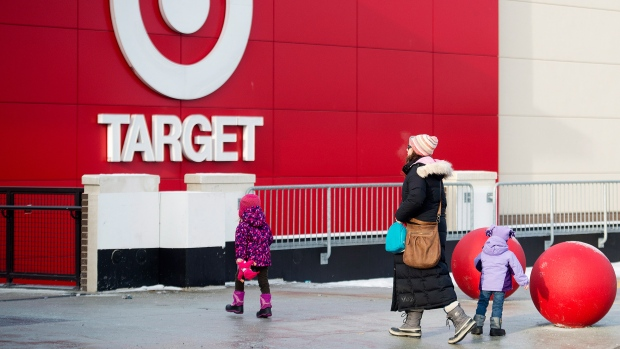 A family arrives to shop at a Target store in Toronto on Thursday, Jan. 15, 2015. (Nathan Denette  / THE CANADIAN PRESS)