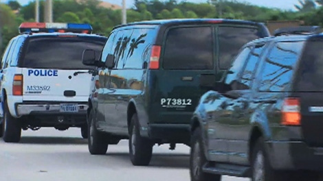 A convoy of vehicles transport Conrad Black from the Federal Correction Institute in Miami on Friday, May 4, 2012.