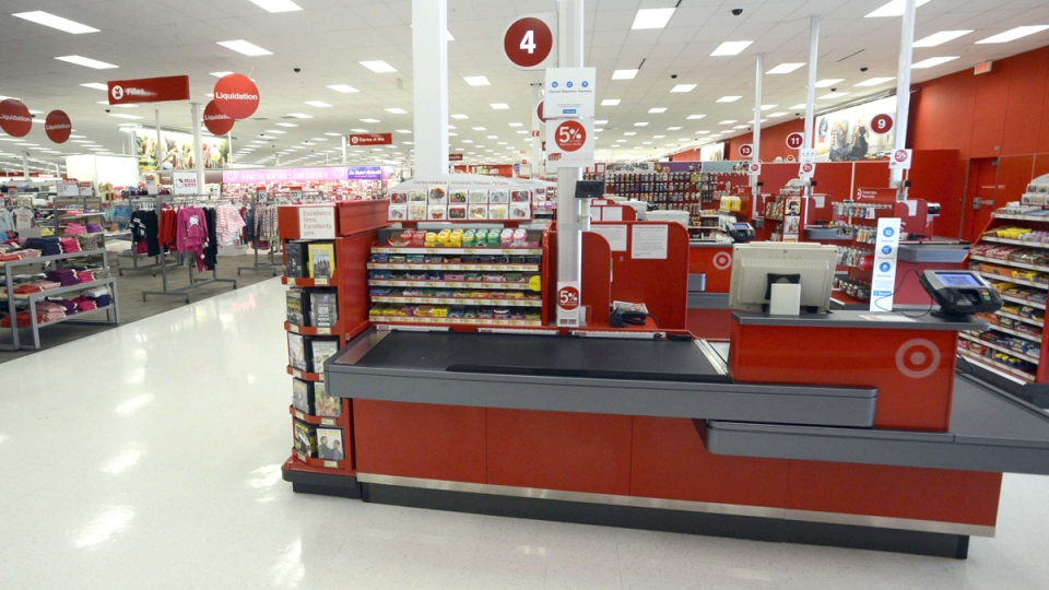 Empty cashier lines are shown at a Target in Saint-Eustache, Que., on Thursday, Jan. 15, 2015. (Ryan Remiorz / THE CANADIAN PRESS)