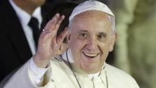 Pope Francis waves to well-wishers in Philippines
