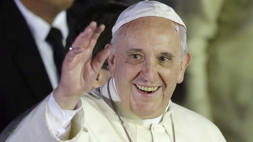 Pope Francis waves to well-wishers upon arrival from Sri Lanka at suburban Pasay city, south of Manila, Philippines, Thursday, Jan. 15, 2015. (AP / Bullit Marquez)