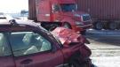 A passenger vehicle and tractor-trailer were involved in a crash on Line 86 near Wallenstein, Ont., on Friday, Jan. 16, 2015. (Dan Lauckner / CTV Kitchener)