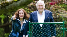 Conrad Black and his wife Barbra Amiel Black watch their two dogs as he arrives at his Bridle Path residence in Toronto on Friday, May 4, 2012. (Nathan Denette / THE CANADIAN PRESS)