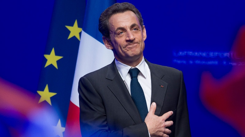 Outgoing French President Nicolas Sarkozy leaves after addressing supporters at his Union for a Popular Movement party headquarters after the preliminary results of the second round of the presidential elections were announced in Paris, Sunday, May 6, 2012. (AP / Michel Euler)