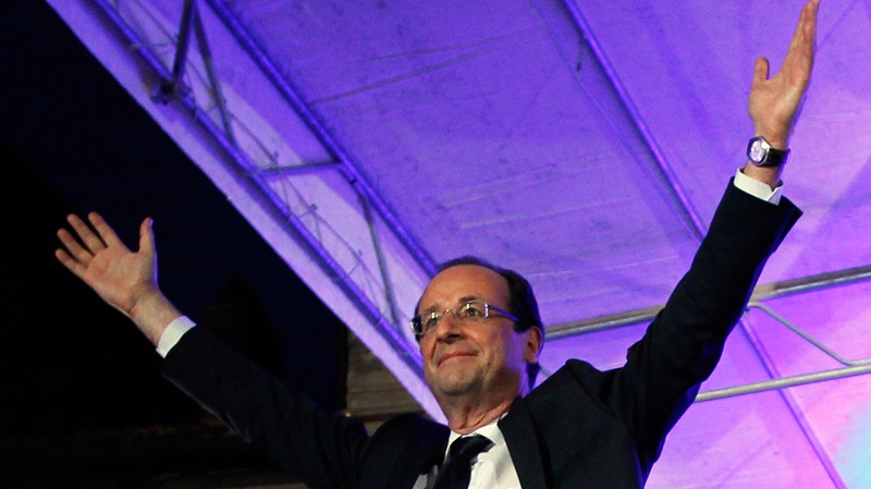 President-elect Francois Hollande waves to the crowd after his election in Tulle, central France