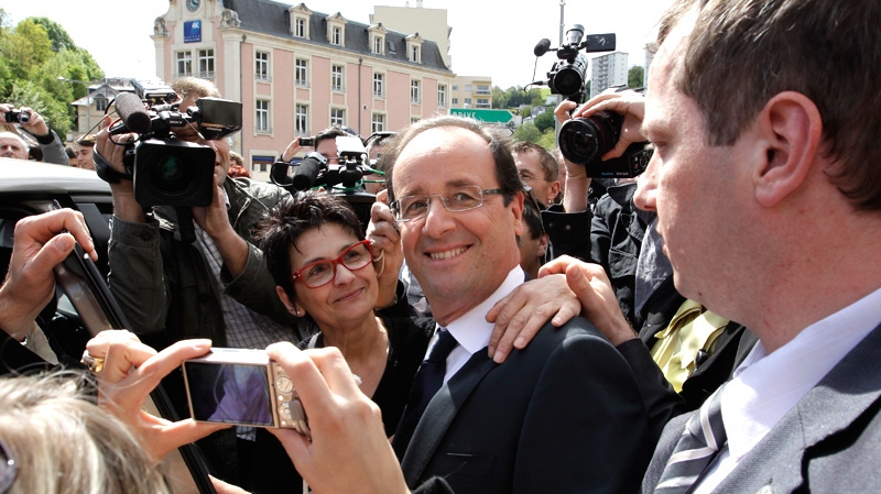 Socialist Party candidate for the presidential election Francois Hollande poses with residents after visiting a polling station near Tulle, central France, Sunday, May 6, 2012. (AP / Lionel Cironneau)